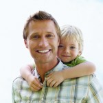 iStock_Father carrying son on back